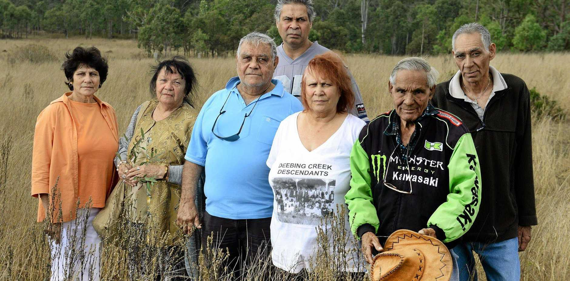 FORCED OFF: Tom Wilmott (second from right) pictured in a file photo last year with Wade Thompson (back) and Aboriginal elders at the former Deebing Creek Mission when they opposed a housing development on the site.