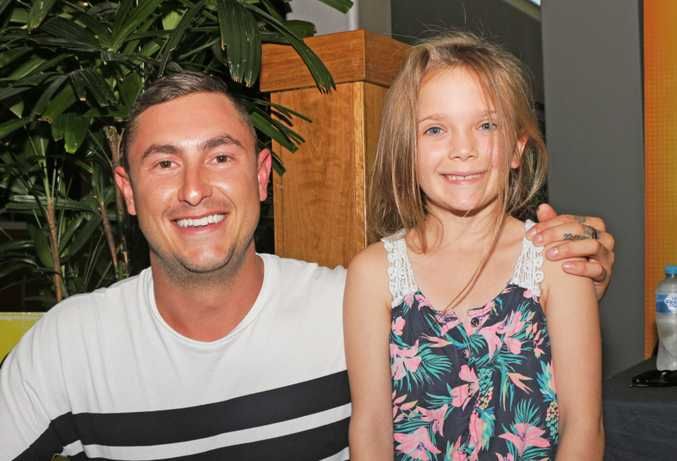 Alex from MKR with his fan Star Davis, who recently made a Moose Cake. Photo Daniel Harkin / Daily Mercury