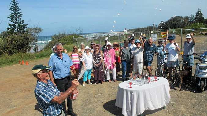CELEBRATION TIME: It was only just over a fortnight ago that supporters of the coastal recreational path were celebrating work starting on the Angels Beach to Sharpes Beach section, but now president of the Northern Beaches Users Club, Denis Magnay, Angels Beach resident David Fuller and others welcome funding for the final section of the path.