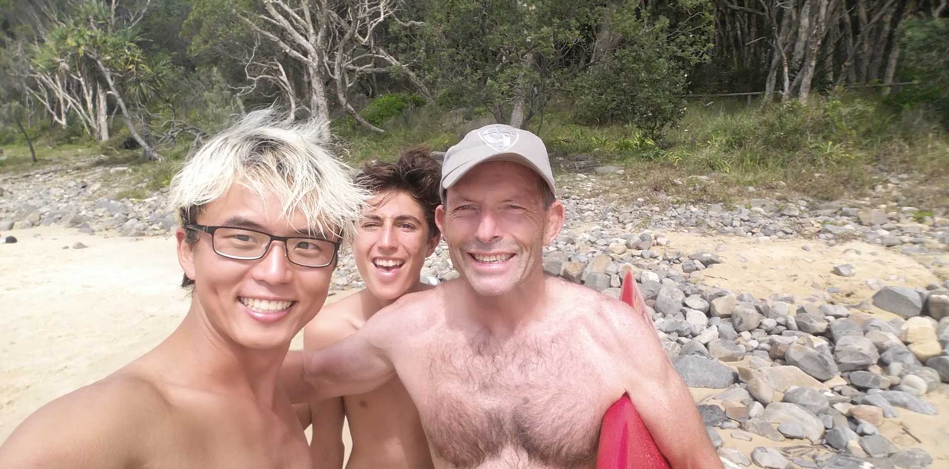 Bongsu Kim (left) from South Korea and Finn Massoud with former Prime Minister Tony Abbott  at Tea Tree Bay in Noosa National Park just after lunch today.