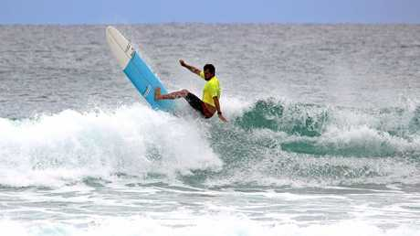 Finalist Harley Ingleby cutting back on a wave in the finals of the Australian Long Board Surfing Open at Kingscliff, NSW on Sunday.