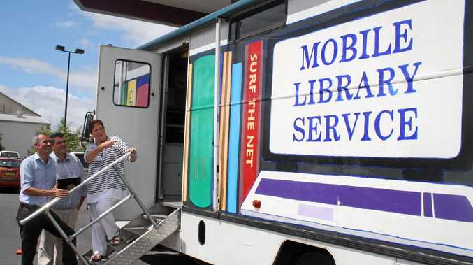 CVC's manager of social and cultural services Dr Judy Banko gives Clarence MP Chris Gulaptis and Mayor Richie Williamson a run down on the enhanced services that will be available when the new mobile library service starts operating in the Clarence Valley.