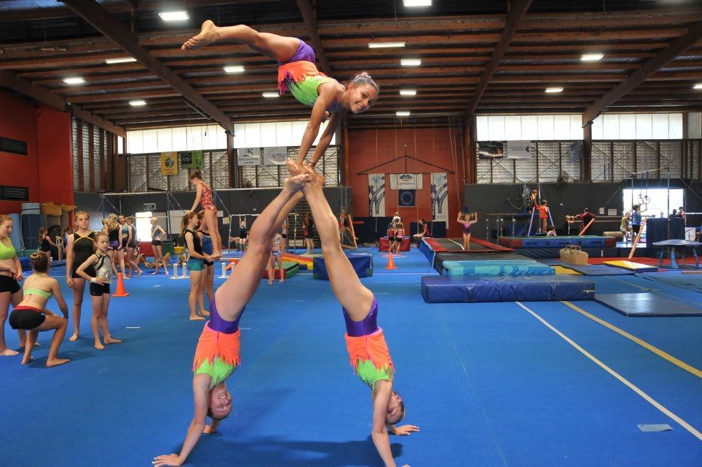 Gladstone Gymnastics Club 12-18 trio, at top Izabeya Jones, left Aime Parker, right Jasmyn Dew.