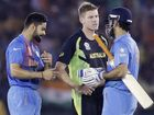 India's Virat Kohli, left, and teammate MS Dhoni, right, are congratulated by Australia's James Faulkner after winning their ICC World Twenty20 2016 cricket match by six wickets in Mohali, India, Sunday, March 27, 2016. (AP Photo/Altaf Qadri)