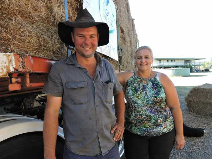 HAY RUN: Truck driver Nathan Doyle and organiser Andrea Hamilton gearing up to help farmers in western Queensland.