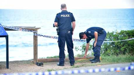 A man has died after his vehicle drove off the cliff on Mcillwraith Street Moffat Headlands landing on rocks below. It appears there was no attemp to stop the vehicle. Police tape marks the area that the vehicle went off the cliff. Photo: Che Chapman / Sunshine Coast Daily