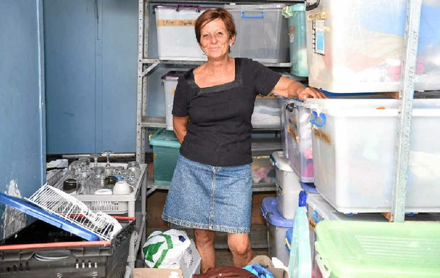 DON'T DUMP: CCA volunteer Gail Wigg with some of the donations the charity receives.