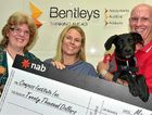 BARKING UP RIGHT TREE: At the launch of Compass Institute's autism assistance dog program are (from left) Leonie Taylor, Peta Grenfell and Phil Brocklehurst with Bentley.