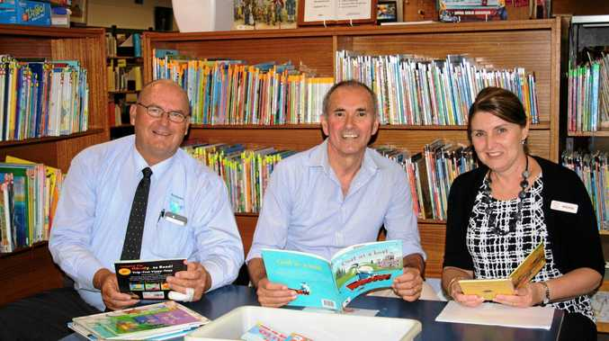 RELAX AND READ: Mayor Ernie Bennett, Clarence MP Chris Gulaptis and deputy regional library manager Sylvia Cooling.