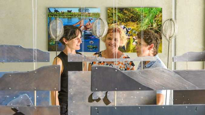 Artists Cass Samms (left) and Tracy Pateman (right) chat with exhibition curator Rochelle Summerfield (centre) as they set up their exhibition at the plunge pop up display in conjunction with Arts Northern Rivers.