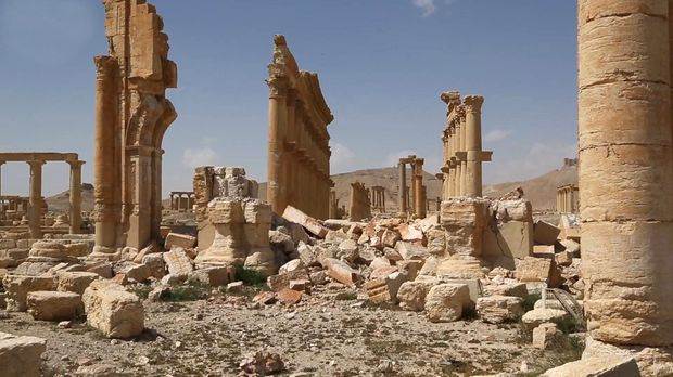 This photo released by the Syrian official news agency SANA, shows some damage at the ancient ruins of Palmyra, central Syria. A Syrian antiquities official says demining experts have so far removed 150 bombs planted by the Islamic State group inside the archaeological site in the historic town of Palmyra.