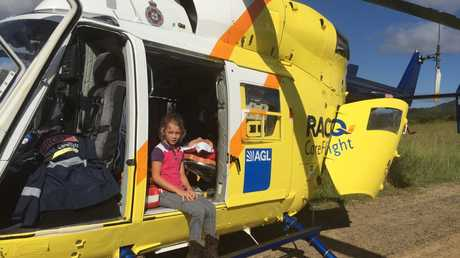LITTLE HERO: Rylee Lavaring sitting in a RACQ CareFlight Rescue Helicopter. Photo: Max Fleet / NewsMail