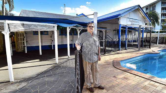 OFFER REJECTED: Paul Hefferan by the pool at the old Kookaburra Resort in Pialba which he says could be turned into housing for the homeless.