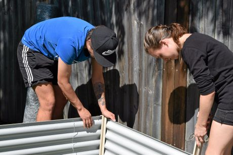Home or at risk of being homeless youths worked together to build a community garden at The Nimbin Transitional Housing Units. From left, residents Zac and Malcha.