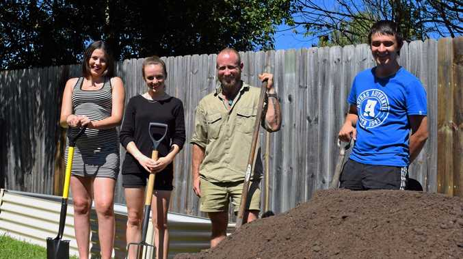 Home or at risk of being homeless youths worked together to build a community garden at The Nimbin Transitional Housing Units. From left, residents Kristy and Malcha, project director Heath Mayne, and resident Zac.