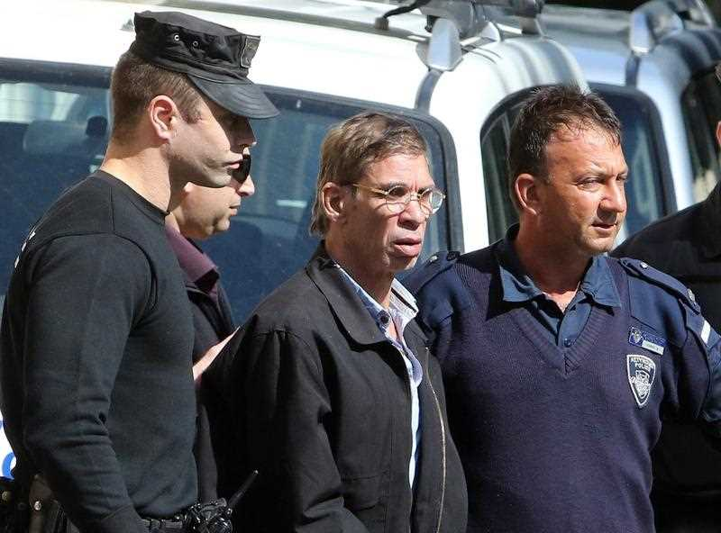 who was arrested after he hijacked an EgyptAir flight, which was forced to land in Cyprus on Tuesday, is transferred by Cypriot police as they leave a court in Larnaca, Cyprus 30 March 2016.