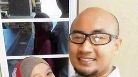 Can you explain the woman's face in the reflection?