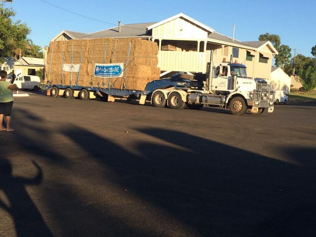 A truck from the Fraser Coast heads out west to join the Burrumbuttock hay run.