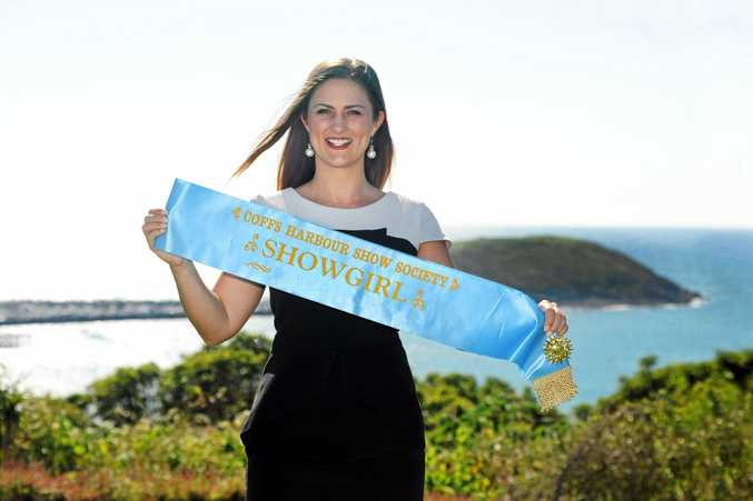THE SEARCH BEGINS: Miss Showgirl co-ordinator Mel Crossland with the winner's sash.