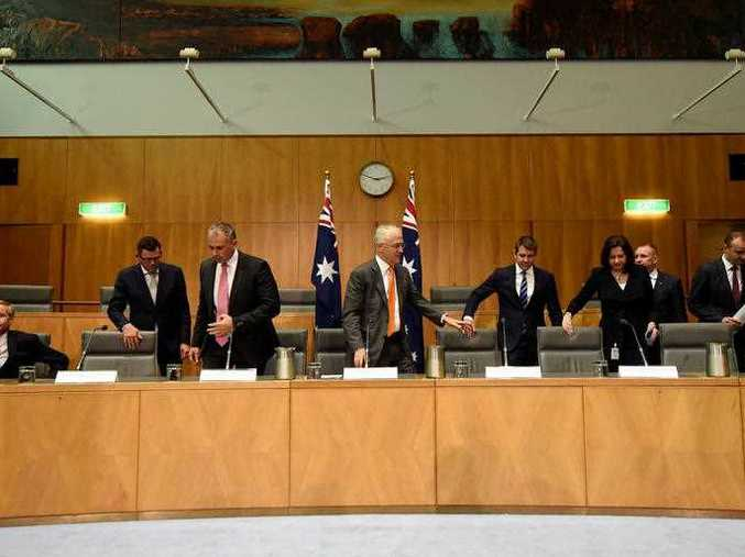 Australian Prime Minister Malcolm Turnbull together with the Premiers and Chief Ministers take their seats during a press conference after the COAG meeting at Parliament House in Canberra, Friday, April 1, 2016. Australian Prime Minister Malcolm Turnbull today met with Premiers and Chief Minister for the Council of Australian Governments.