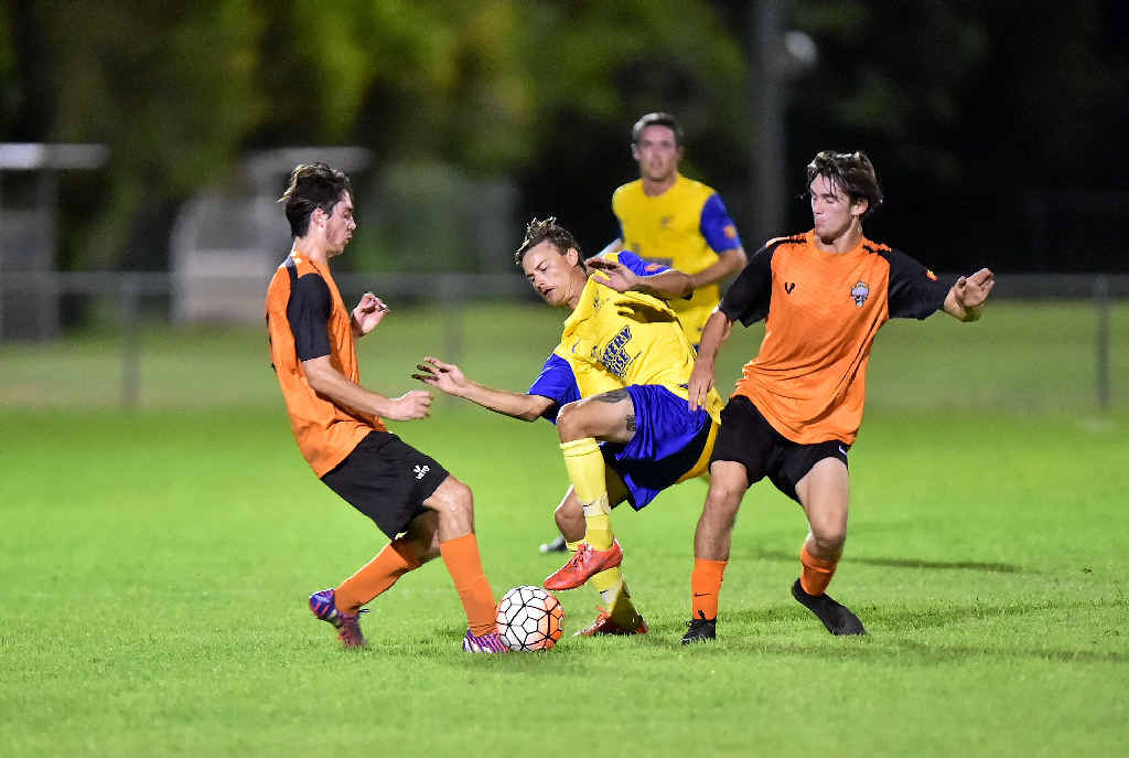SHUT DOWN: Kawana's Kayden Oakes tries to keep the ball under pressure from Buderim's Jed Zanos (R) and Alex van Kampen.