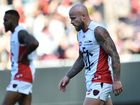 Nathan Jones trudges from the field after his Demons suffered defeat at the hands of the Bombers. Photo: AAP Image