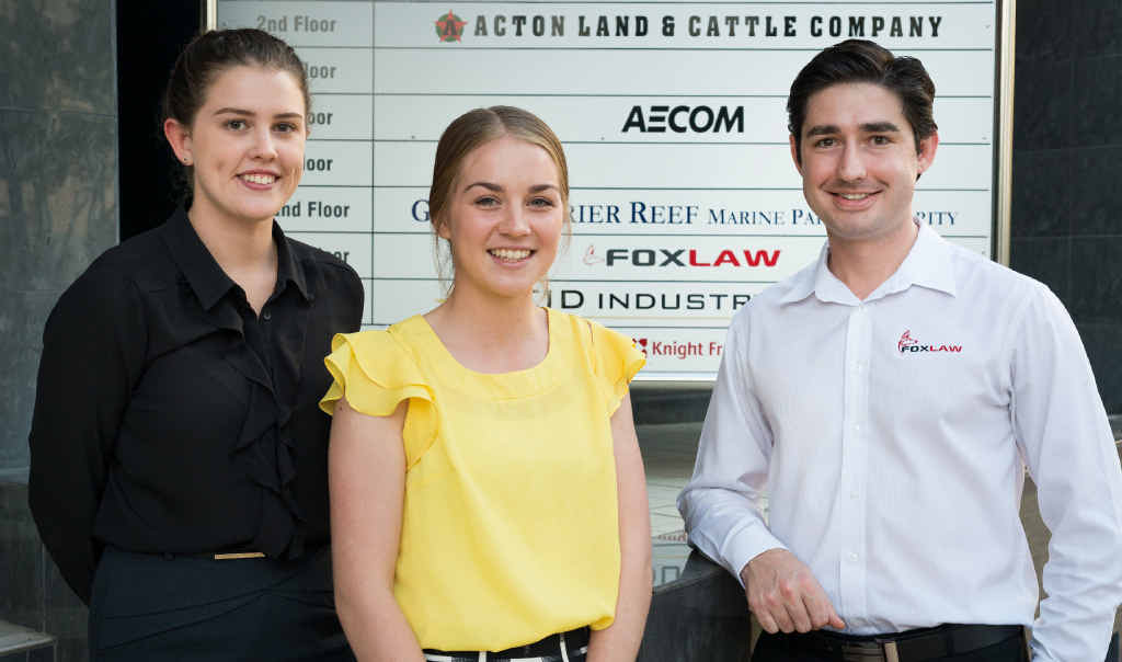CELEBRATING BUSINESS: Lawyer Josh Fox (right) pictured with colleagues Jenna O'Donnell (left) and Stacey Kennedy (middle) celebrate the law firm's third anniversary.