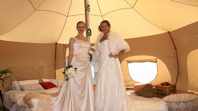 DRESSED TO IMPRESS: Models from the Theresa-Anne agency wear dresses by Janelle from Mary Vidler Bridal inside one of Glamp OZ's tepees at the Lismore Rotary Bridal and Events Fair.