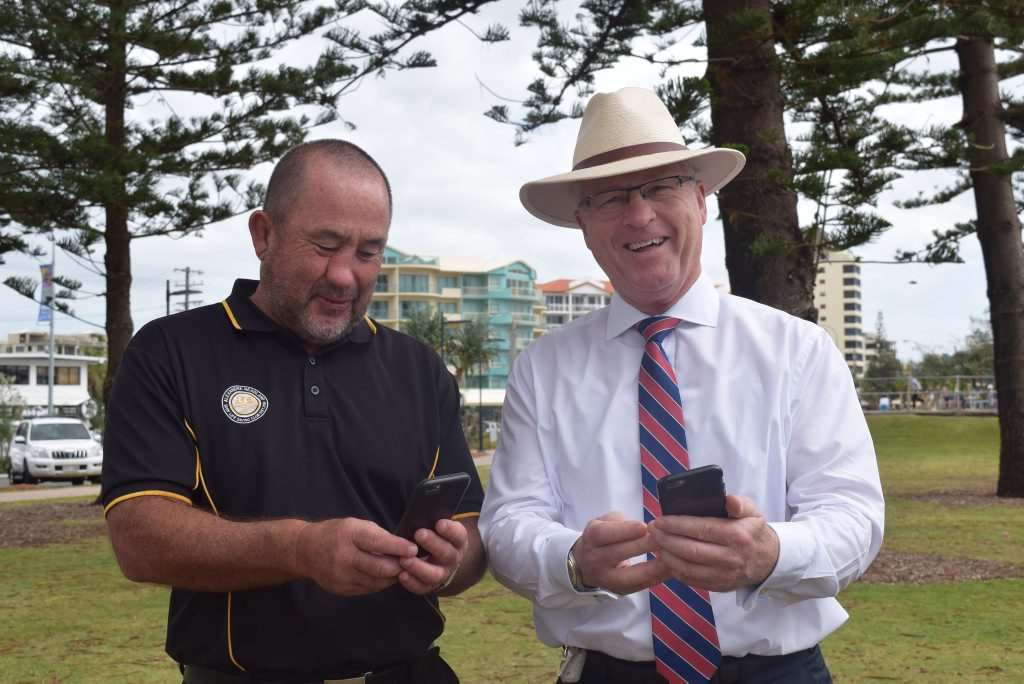 BETTER CONNECTION: Alex Surf Club general manager Ashley Robinson and mayor Mark Jamieson test out the new WiFi. Photo Lucy Cantori / Sunshine Coast Daily