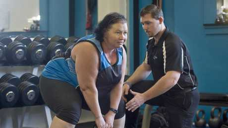 FITNESS CHALLENGE: Rebecca Ruse has challenged the men that mocked her to a fitness challenge, she's pictured with her personal trainer and owner of Zenon Fitness Robert Gillis.