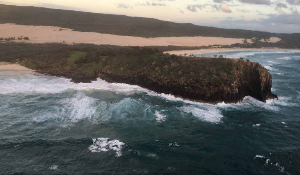 ROUGH SEAS: The search has been called off for missing fishermen David Chivers, inset, and Matt Roberts whose trawler, Cassandra, went missing in rough seas five miles east of Waddy Point on Fraser Island.
