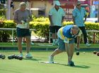 GOOD TOUCH: Barry Brown rolls one down at Mackay Bowling Club yesterday, with Bert Eykenbbom in the background.