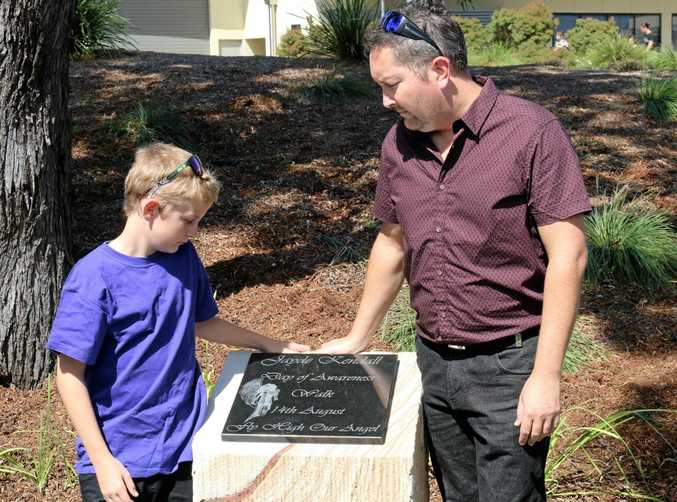 Jayde Kendall's brother Brandon and father Bruce Morrissey stand with the memorial in her honour which was unveiled at the Lockyer Valley Cultural Centre on Tuesday.