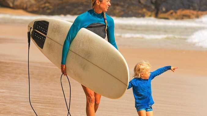 Byron Bay surfing mums coordinator Sally Gudge with her son Kai. Photo: David Freund