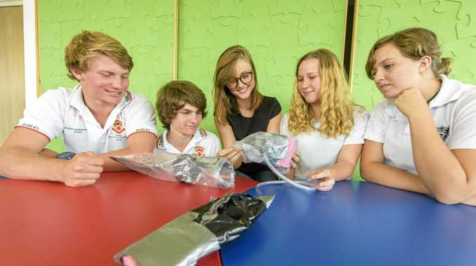 NEW PROGRAM: QubeRider co-founder Solange Cunin (centre) with students Caleb Barker, Scott Rose, Grace Spies and Kirsten Scott at a workshop at Grafton Library.