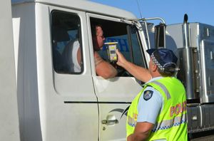 TESTING: Truck driver pulled over during Police operation to reduce the road toll. Photo: Jodie Dixon / Isis Town & Country
