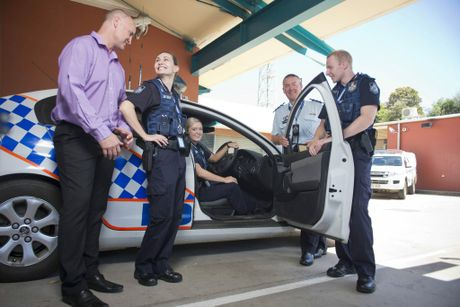NEW COPS ON THE BEAT: Oliver Hodges, Sarah Box and Sam Engel are fresh out of the academy and have joined Gladstone and Tannum Sands police stations. Inspector Darren Somerville and Gladstone MP Glenn Butcher Photo Paul Braven / The Observer