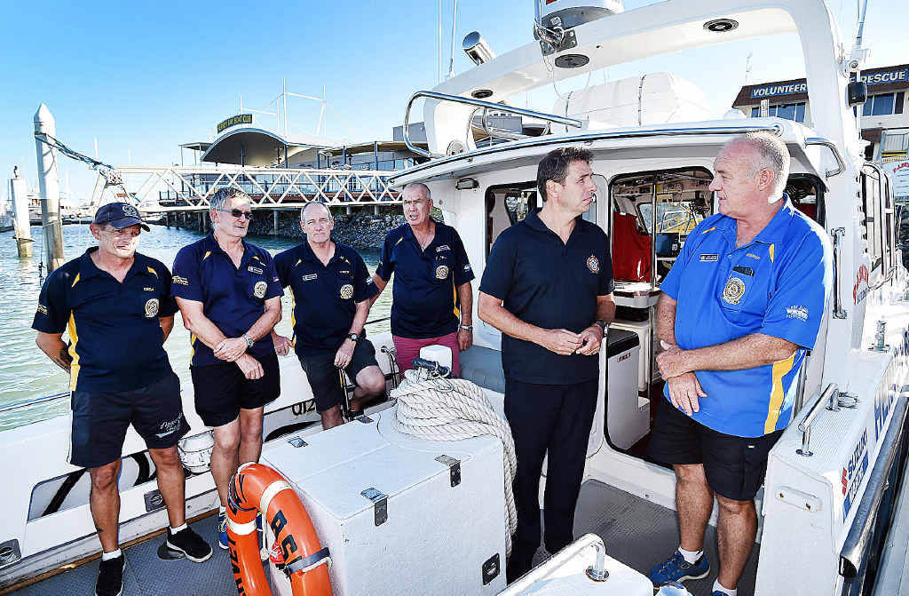 RESCUE: (Front right) Queensland Emergency Service Volunteers' deputy commissioner Mike Wassing talks with Commodore John Smith. (Back from left) crew members Joe Ognjenovic, David Marshman, Colin Goldsworthy and Ray Harris.