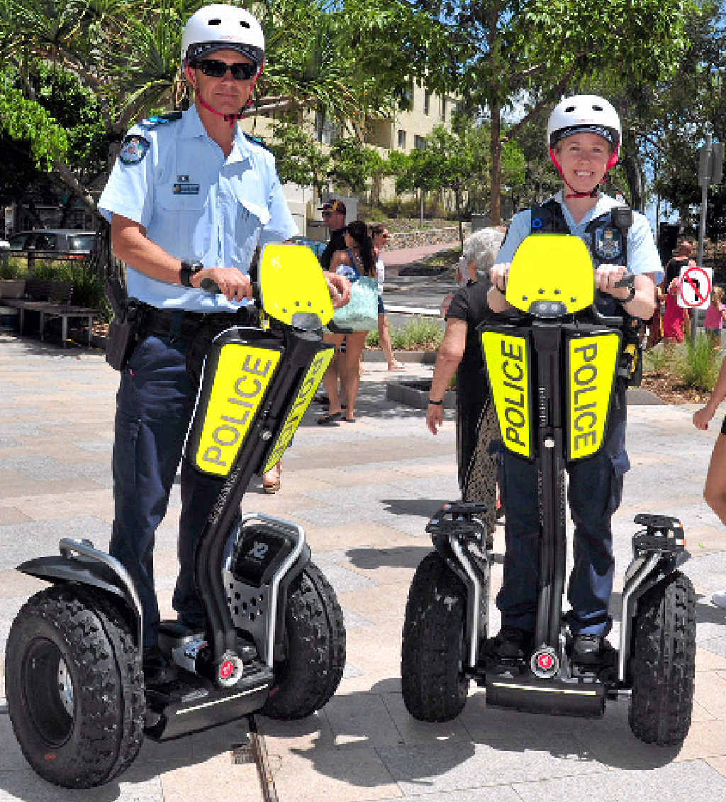 ON FOOT: Senior Constable Pierre Senekal (left) and Constable Karina Hawkins on their segways in Hastings St Noosa during the trial.