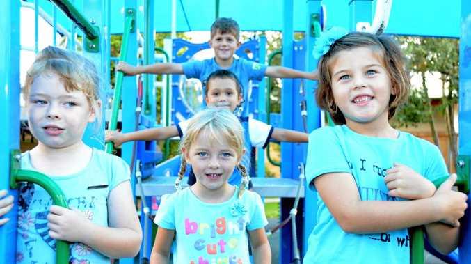 Emma Gibson, Skylar Semmens, Harrison Lafaitele, Gus Weir and Pixie Hodgson wear blue for World Autism Day at Centaur Primary School on Friday.