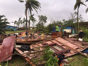 Fiji battening down for cyclone, as floods claim two victims