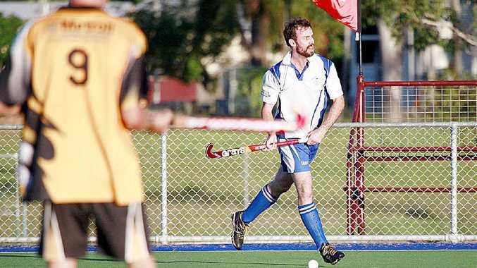 TOUGH BATTLE: Wallaroos' Tony Dakin aims his hit in the men's hockey match against Granville in Maryborough on Saturday.
