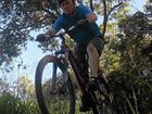 IMPRESSIVE: Mountain biking enthusiast and track builder Ian Masters hits an obstacle on the Mackay track.