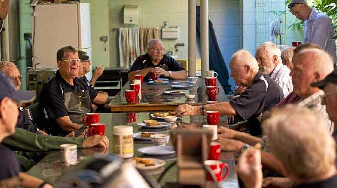 MEN OF ACTION: Gladstone MP Glenn Butcher visited Gladstone Men's Shed for morning tea in their cramped building on Oaka Ln. GLA070415SHED_3.jpg