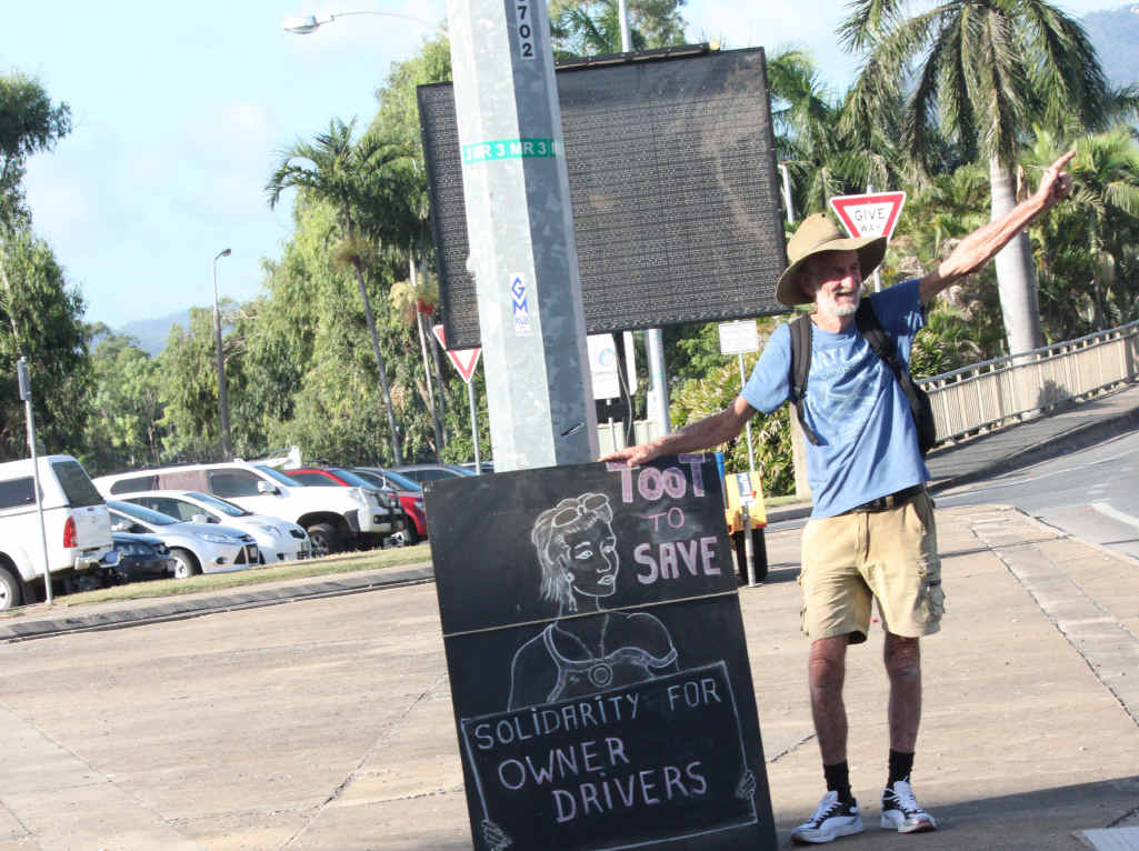 SILENT PROTEST: John Partridge hopes his sign on East St intersection will make drivers think about the new road transport industry legislation.