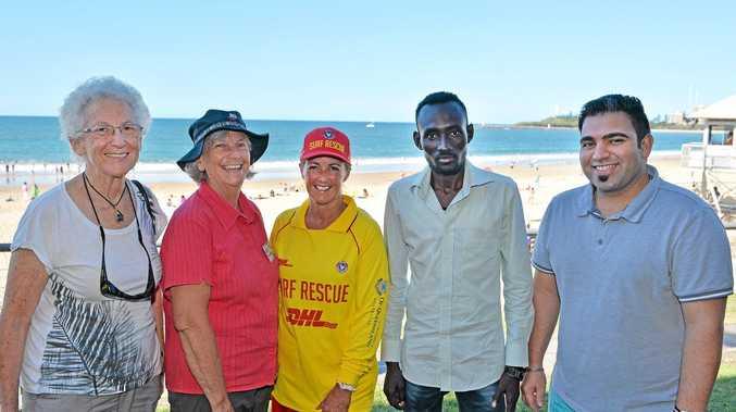 HELPING HAND: Buddies on the beach. (LtoR) Kayla Szumer, coordinating teacher Margaret Norris, Mooloolaba life saving manager Sally Taylor, and asylum seekers Milad and Abozare.