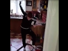 An Irish father pranks his son, getting him to pull the cord to start the vacuum.