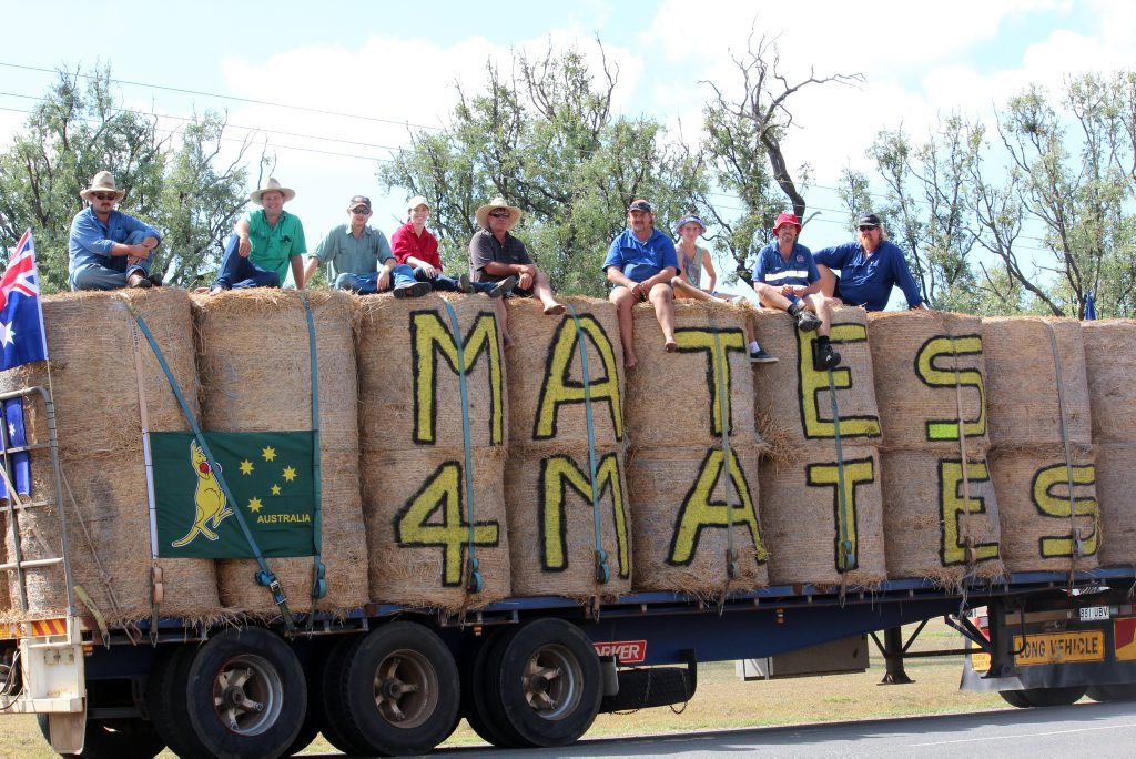 Greg Lang (sixth from left) and his supporters ready to leave Moura and join the Burrumbuttock Hay Run. Photo Stacey Rudd / Central Telegraph
