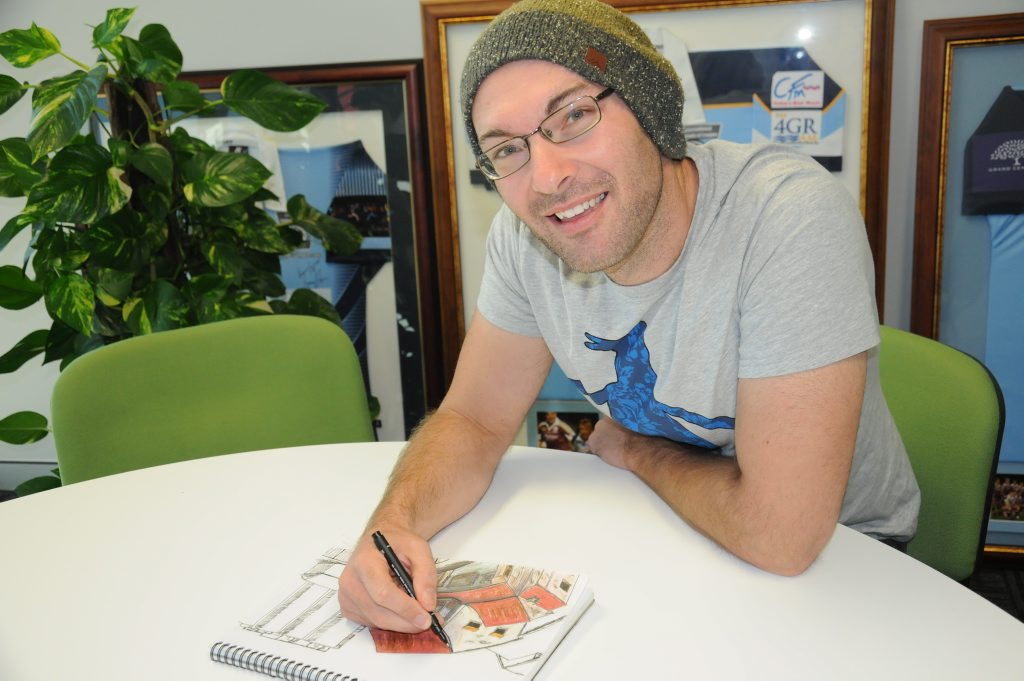 Damien Johnson sketches buildings in Toowoomba.