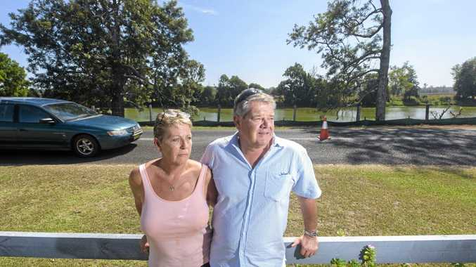 Sue and Bill Robson at the front fence of their Southgate property where roadworks are moving the road even closer to their house.